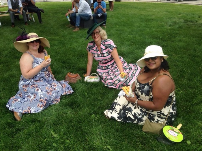 Refined ladies eating hotdogs in the grass ... Classy!