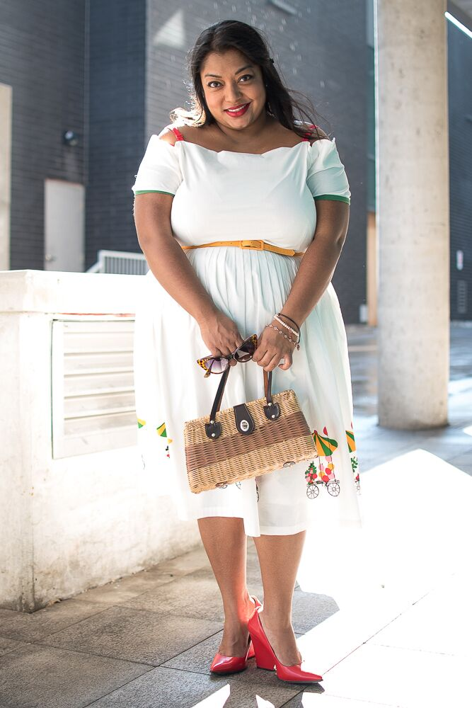 Petite Plus, Meow! wearing Tatyana Flower Cart dress